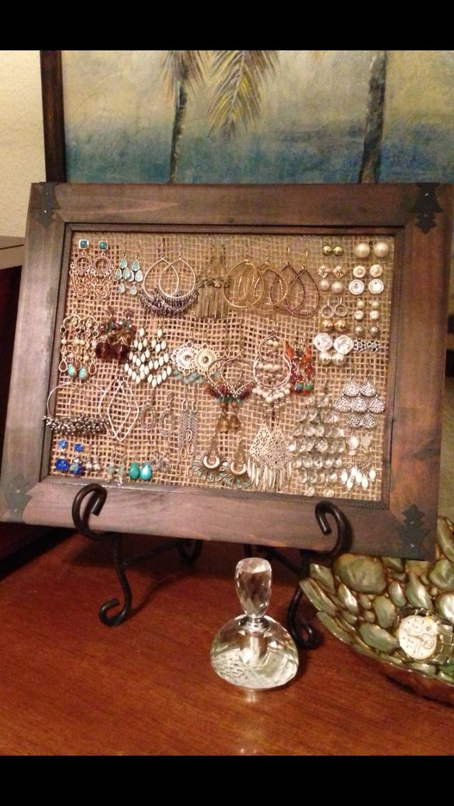 Jewelry organizer! Made by using a frame and stapling burlap to the backside. Works great for dangly and stud earrings!