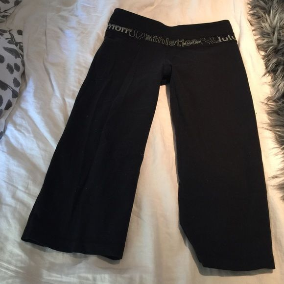 Lululemon luon reversible crop pant Lululemon luon reversible crop pant.  Lightly worn.  Reversible with silver text on waistband. lululemon athletica Pants Ankle & Cropped