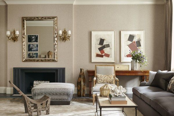 On the other side of the room, an ottoman is covered in a Holly Hunt fabric, a studded chair was found at Lucca & Co., and works by Joel Shapiro hang on the wall.