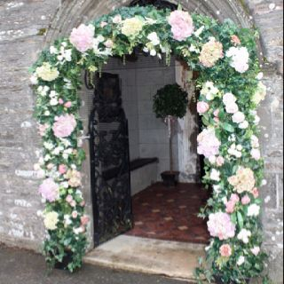 pink silk flower wedding arch to hire and cornwall tie the