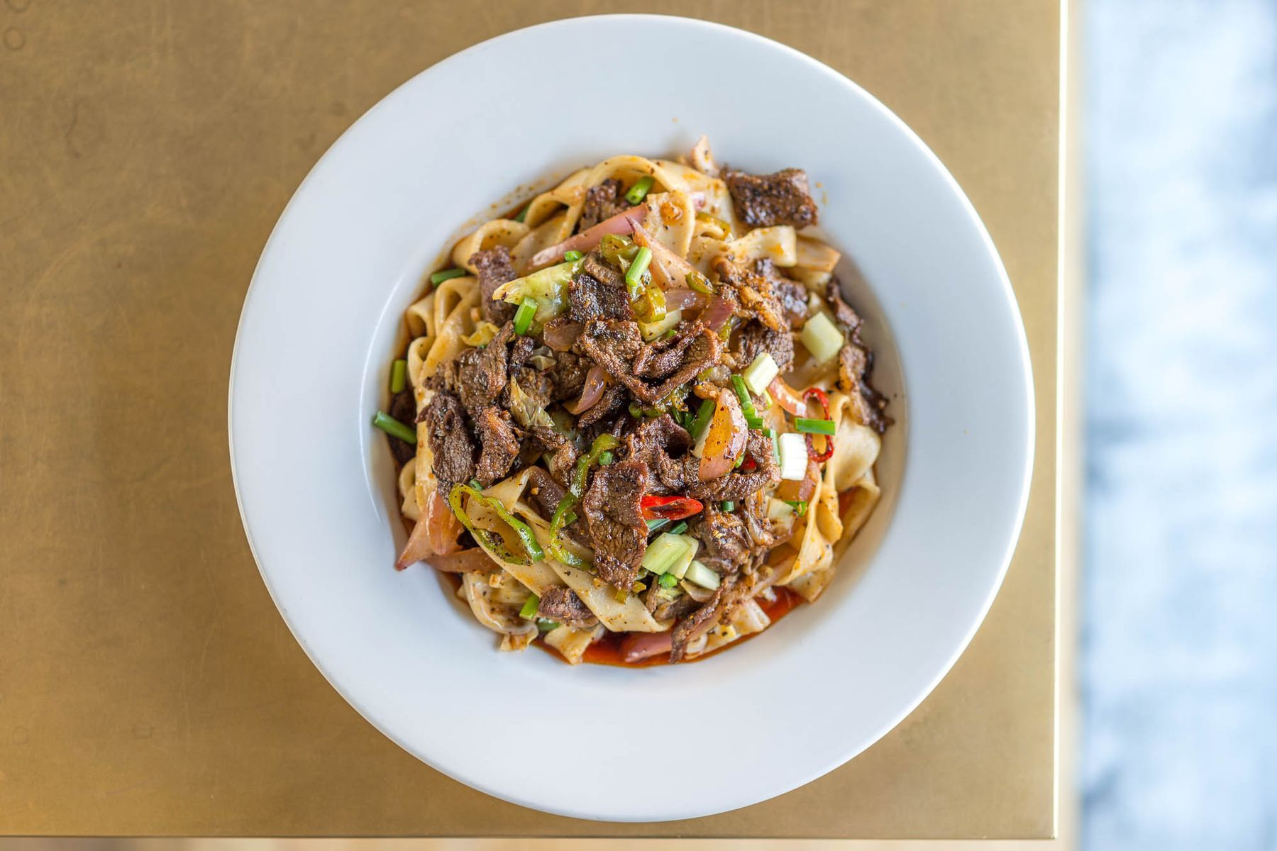 At Xi An Famous Foods A Father And Son Connect Over Spicy Lamb Noodles Nyc Food Best Chinese Food Chinese Restaurant