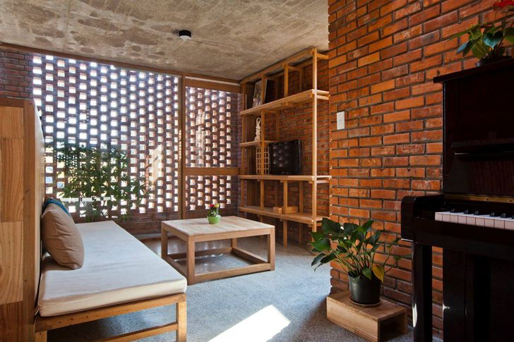 awesome red brick wall interior design | Passively-cooled Termitary House in Vietnam is wrapped in ...