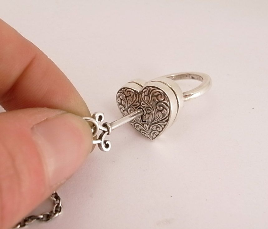 omg - i love this so much!!! Sterling Silver Locking Engraved Heart Ring with Seperate Key. $750.00, via Etsy.