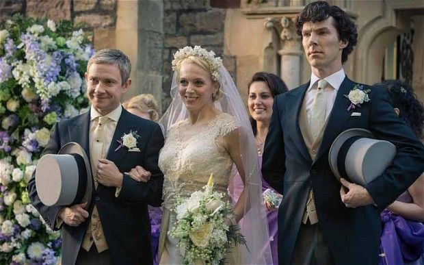 Sherlock seems to be having rather less fun than the bride and groom in this picture