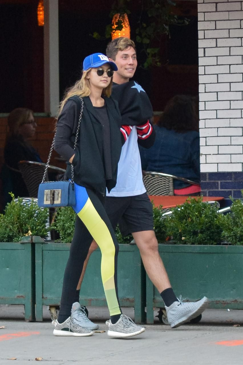 Gigi Hadid wearing Adidas Yeezy Boost 350 Sneakers, Alo Yoga Ascendant  Leggings and Tom Ford