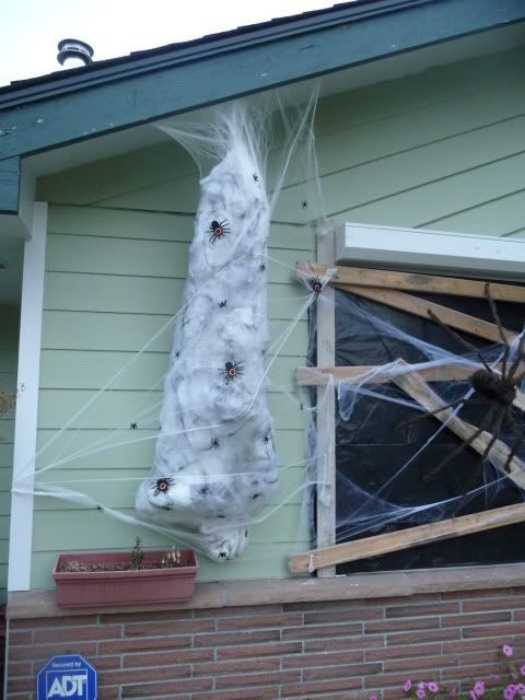 how to make a spider victim just add a giant spider on its creepy web halloween spider decorationsdiy