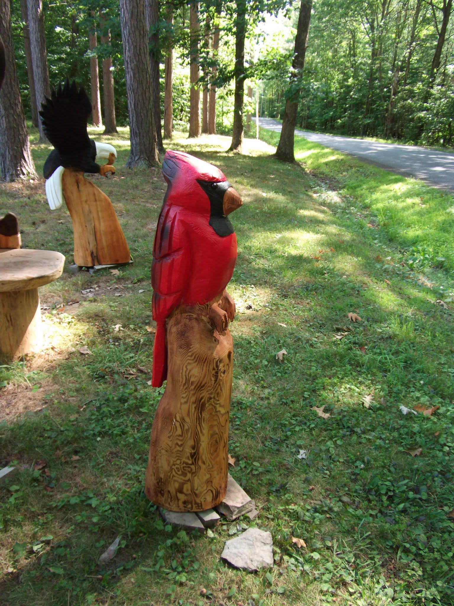 cardinal chainsaw carving by carvnstitch | chainsaw carvings, Gartengerate ideen