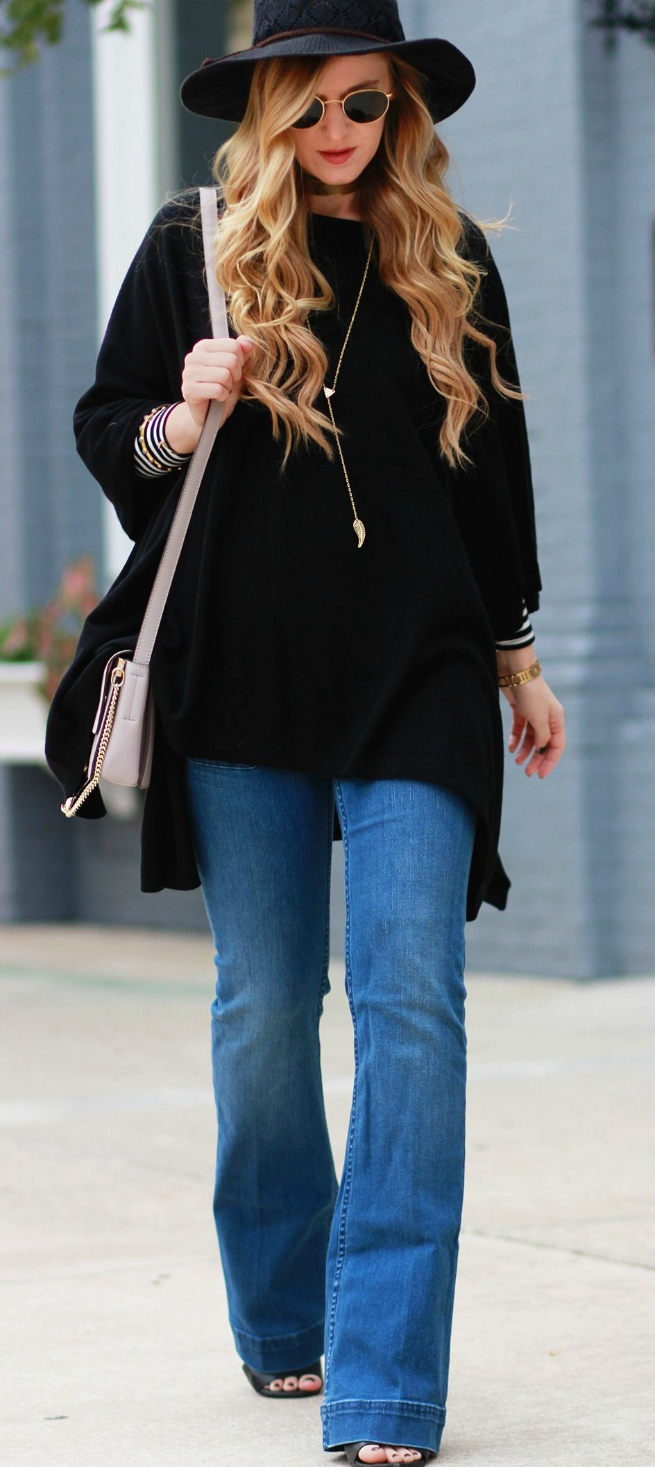 a94e8d40f5 Casual winter outfit styled with a cashmere black poncho paired with a striped  shirt