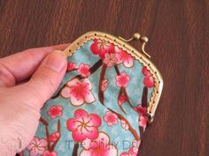 Sewing Tutorial: How to make a coin purse with a purse frame and fabric scraps.