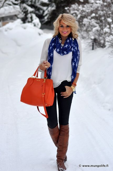 white top, black pants, orange purse and bracelet, gold jewelry, blue scarf