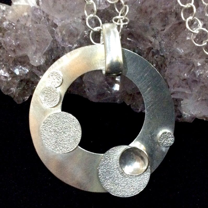 A personal favourite from my Etsy shop https://www.etsy.com/au/listing/262981774/bubbles-encompassed-sterling-silver