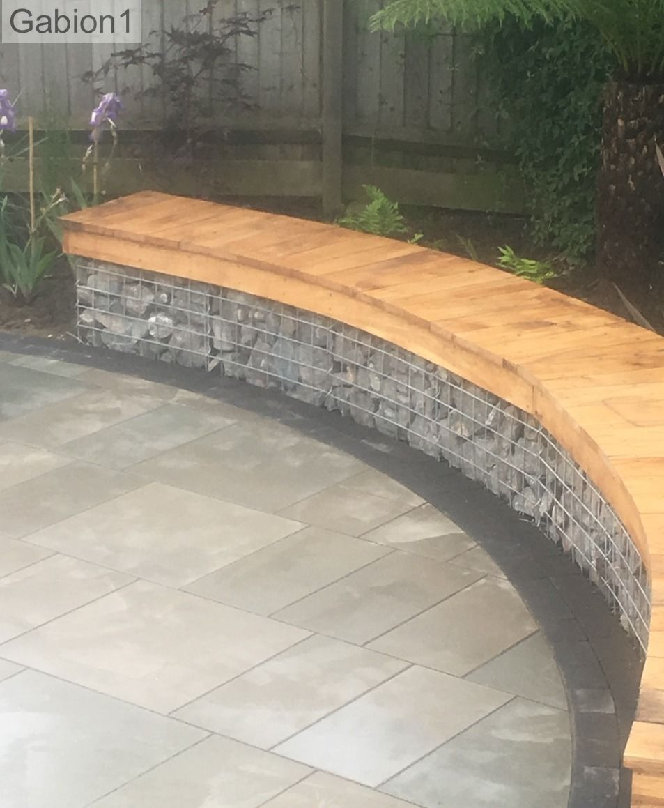 Curved gabion garden seating with timber tops http www for Curved garden wall ideas