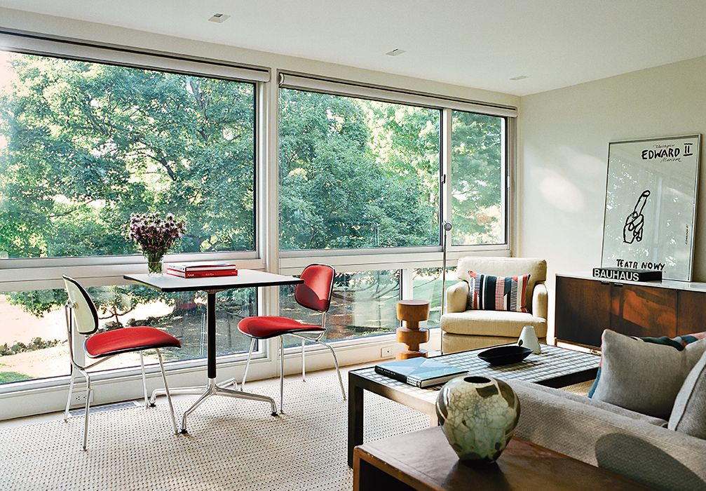 Modern guesthouse renovation in New York living room with Eames