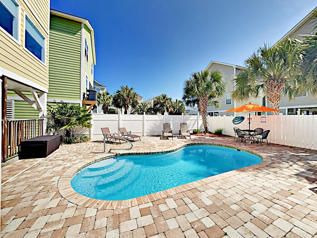 Offering a garden and free WiFi, Surfside Stunner Unit B