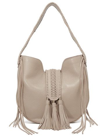 ab858c6759 Bohbo hobo bag by GRACE ATELIER DE LUX. A braided magnetic strap with  tassels crosses the top of this pebbled leather GRACE ATELIER DE LUX hobo  bag.