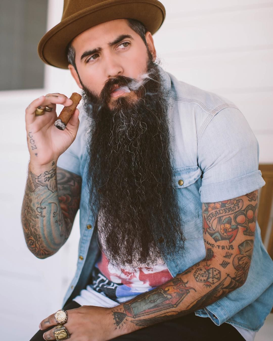 Trig perez full thick very long black beard mustache for Bearded tattooed man