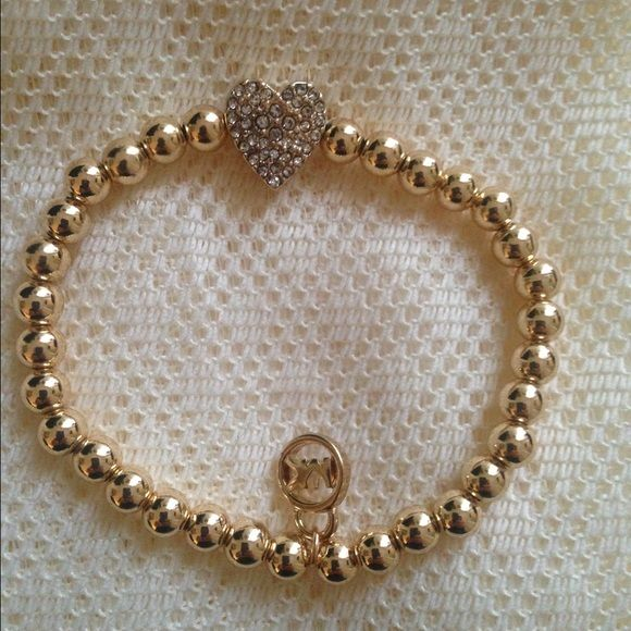 59867e8a6ece Michael Kors beaded bracelet with pave heart nwot Michael Kors gold tone  beautiful beaded stretch bracelet with pave heart with crystals. Nwot.
