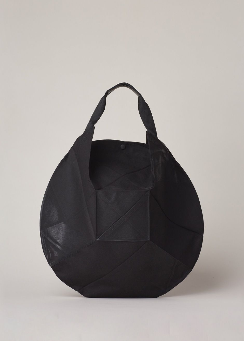 8e57c15aa5 Issey Miyake Origami Bag (Black Luster) - Rounded geometric origami folded  bag in black coated canvas with a snap closure at top. Cowhide