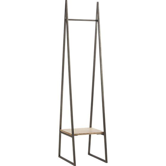 Pin for Later: 11 Decor Scores to Help You Stay Organized  Instead of a traditional coat rack, this sleek Butler Stand ($199) can accommodate coats, handbags, and hats, thanks to the small built-in shelf.