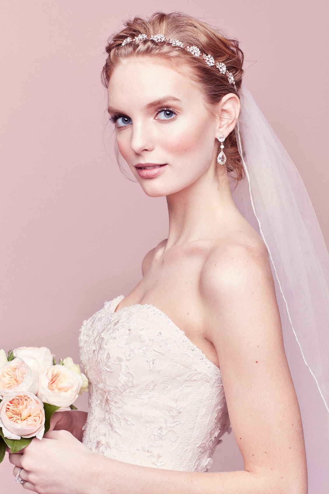 Pair a halo headband with a back-of-head placed veil for a bohemian ...