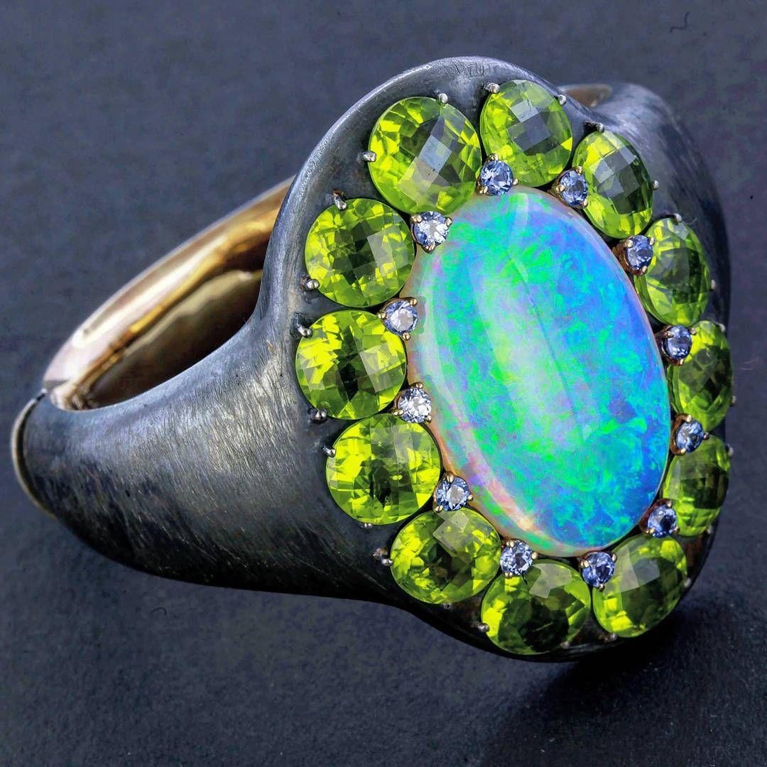 """Australian opal, Burmese peridot and Montana sapphire bracelet on brushed silver and rose gold.  #taffinjewelry #taffin #jamesdegivenchy…"""