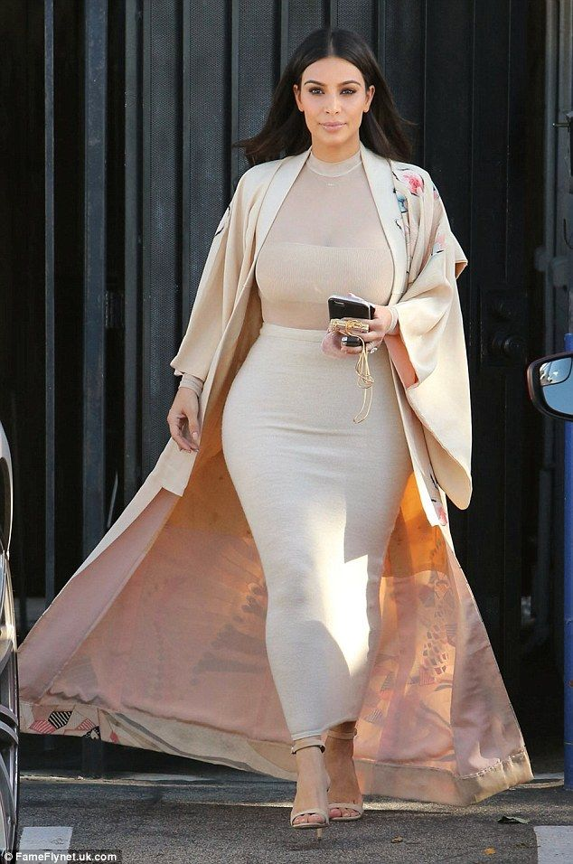 7c17ac91d8 Glam  Kim Kardashian wore a dramatic kimono-style as she left the family s  studio in Van Nuys after a day of filming on Wednesday