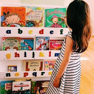This beautiful #Kid is enjoying some #reading with the Tidy Books #Bookcase #Kidsbook