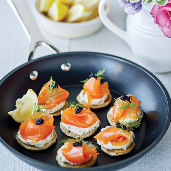 Blinis topped with smoked salmon and a dollop of caviar are easy to make and assemble. These great little snacks will add a tinge of glamour to even the most down-to-earth gathering.