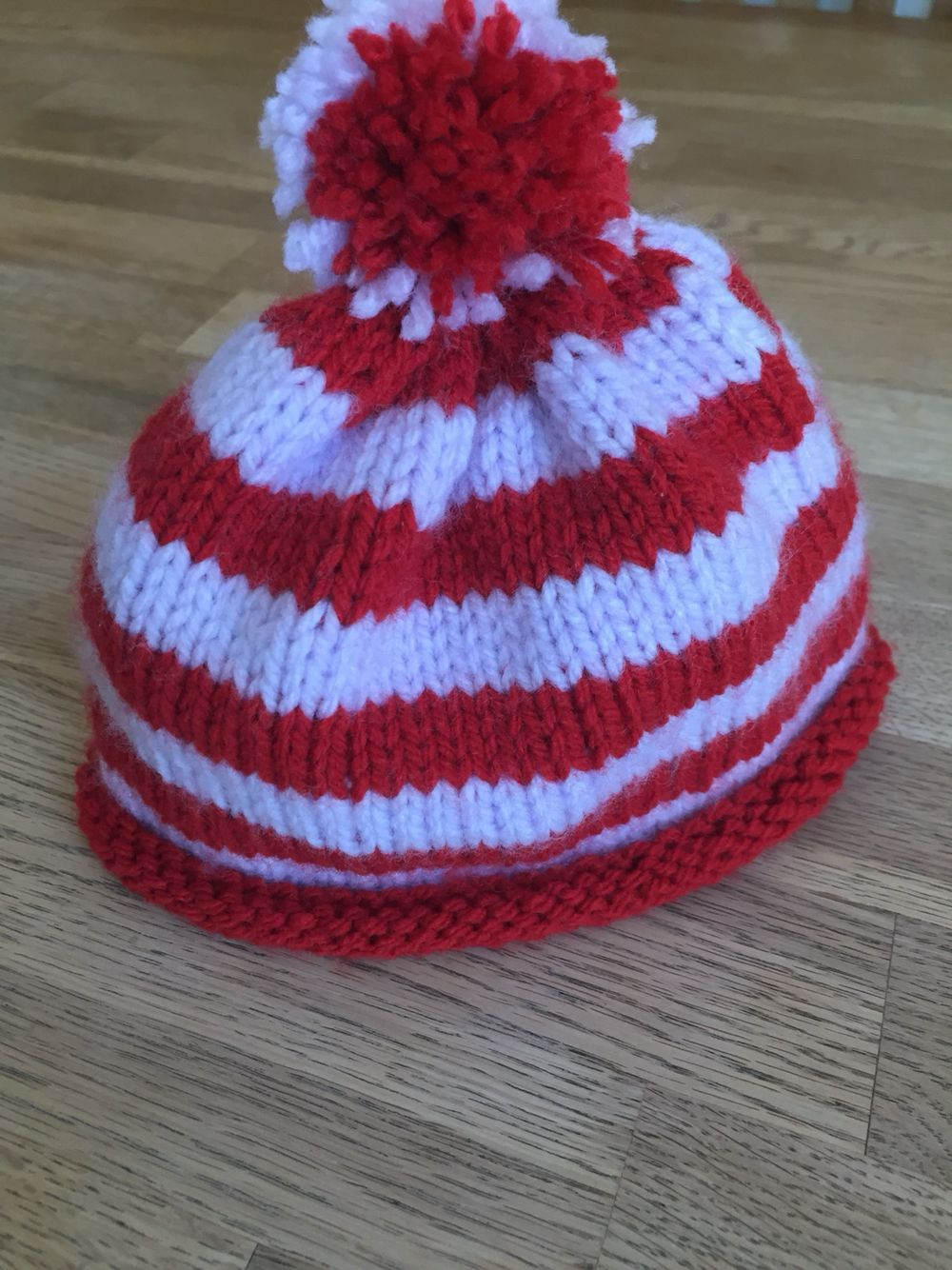 Knitted baby hat with pompom made in circular needles. I took the ...