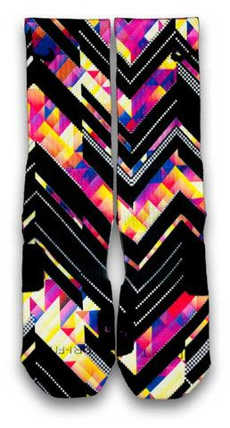 Kaleido Xffects Nike Custom Elite Socks. Featuring an illustrative kaleido effect infused with black solid line pattern. This pair of custom elite socks comes in a multi-color square print with enhanced white pixels. Style with any sneaker.