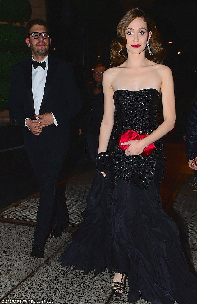 Glam girl! Emmy Rossum looked incredible in a glittering black gown as she made her way to...