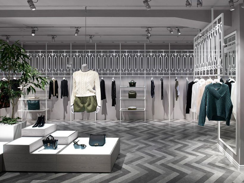 d1a38c3746 GOod use of dead space above racks... nendo designs compolux luxury retail  store interior in tokyo. nendo designs compolux women's luxury clothing ...