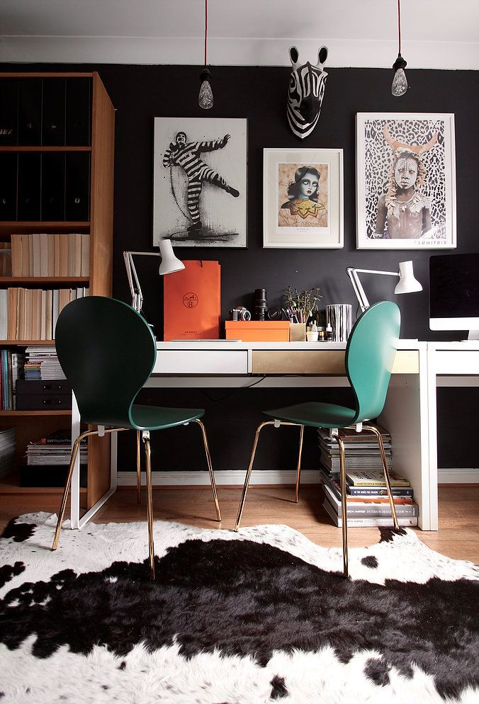 Farrow and Ball Railings in a blogger's home office. Make a bold statement by painting only two walls in your room. Designer office look on a budget using IKEA furniture like the Billy bookcase and desk. long desk arrangement. These are the Made.com KITSCH chairs in racing green and brass. Cowhide rug. Monochrome home office. Eames DAW chairs in black and banana leaf cushions. Hermes bags and white Anglepoise lamp. Interior design ideas and tips for your home decor. wood flooring