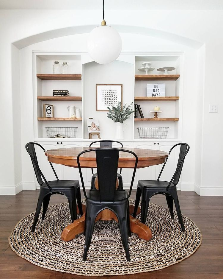 Neutral Farmhouse Dining Room Black Bistro Chairs Wood Pedestal Table Built In Shelves Minimalist D Modern Dining Room Dining Room Design Dining Room Decor