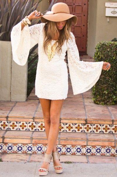 bohemian. white dress. wide sleeves. wide brim hat. sandals. tiles.