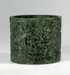A magnificent finely carved spinach-green jade brushpot, Qianlong period (1736-1795)
