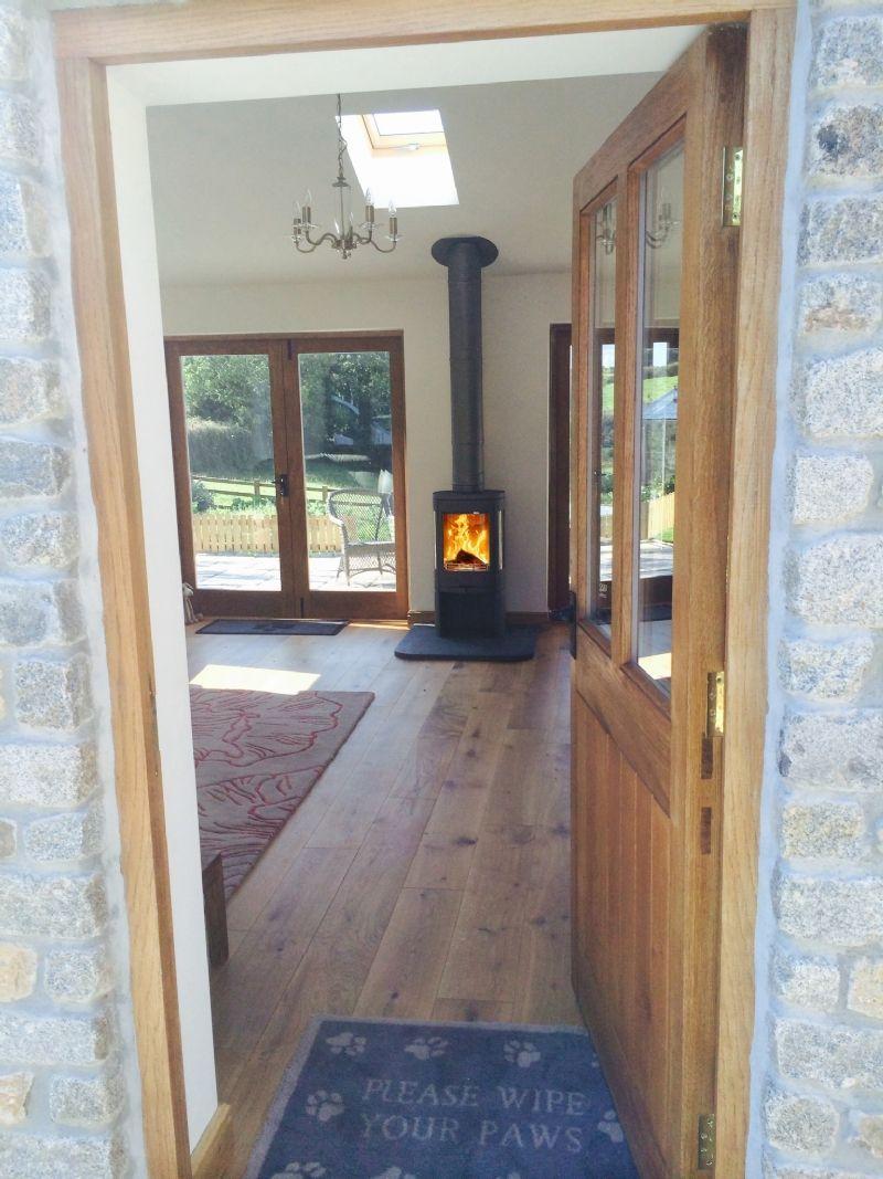 Contura 850 Between Two Doors Wood Burning Stove Installation From Kernow Fires In 2020 Freestanding Fireplace Modern Wood Burning Stoves Wood Burning Stove Decor