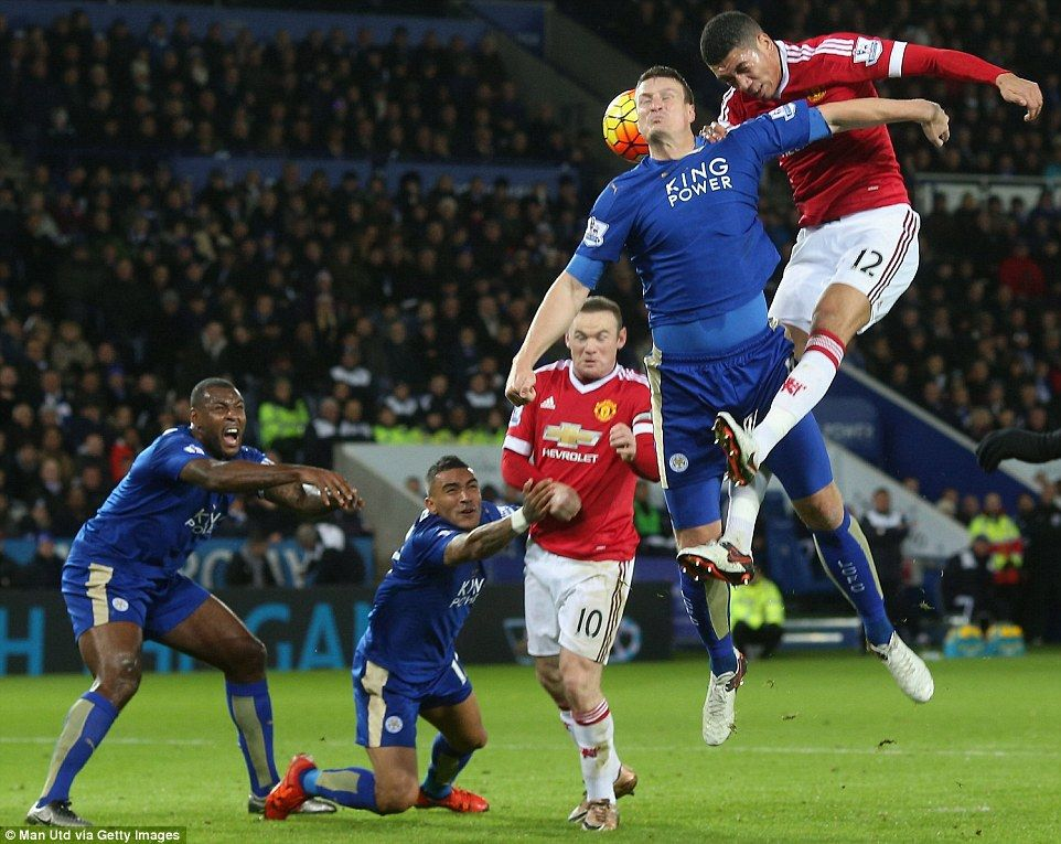 Manchester United centre back Chris Smalling climbs above the Leicester defence to power a header towards goal in the second half