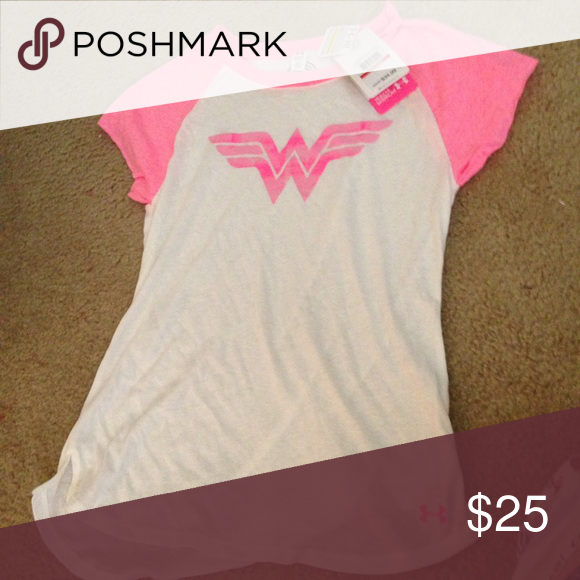 Under armor pink Breast cancer Wonder Woman shirt Brand new with tag. Support breast cancer shirt with Wonder Woman logo. Tag $34. Size xs Under Armour Tops