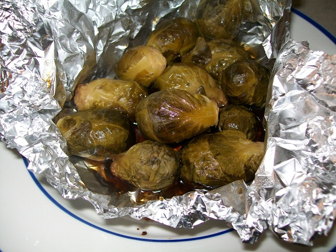 Simple Crock-Pot Side dish add brussel sprouts, brown sugar and olive oil to a foil pack and cook in crock-pot.  Vegetables come out sweet and tender.