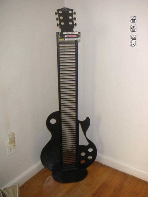 Unique/Guitar-looking design CD Jewel Case Storage Floor Tower Rack - holds 60 Single Standard CD Jewel Cases [MsFrugaLady on eBay, media organizer]