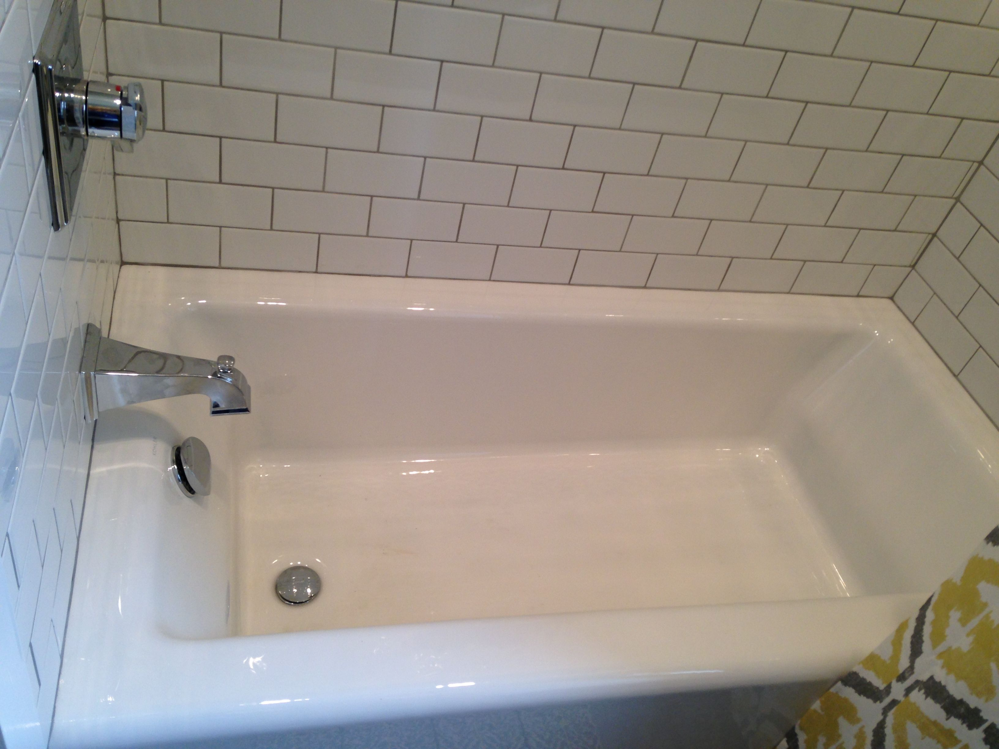 Kohler Cast Iron Tub. White Subway Tiles. Delta Fixtures. Plumbing And  Design By Top Tier, LLC.