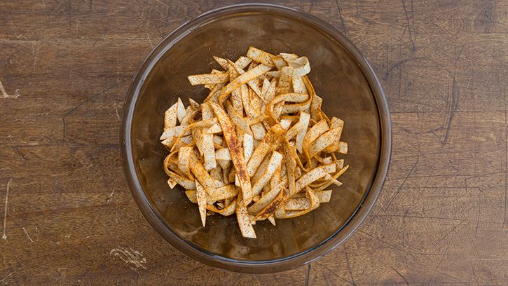 A great topping for salads—and even entrees and appetizers!—these homemade tortilla strips are so amazing you'll be throwing them on everything for a salty, crunchy finish.