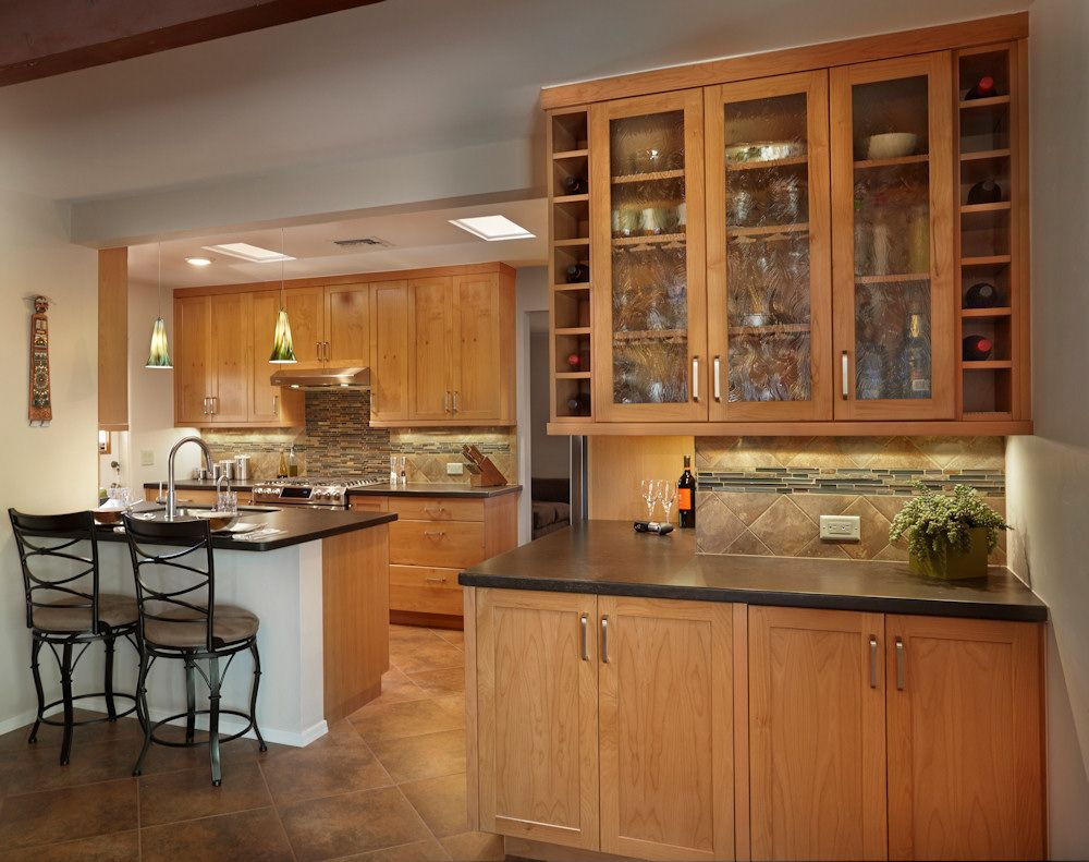 Image result for cherry shaker cabinets black quartz countertop