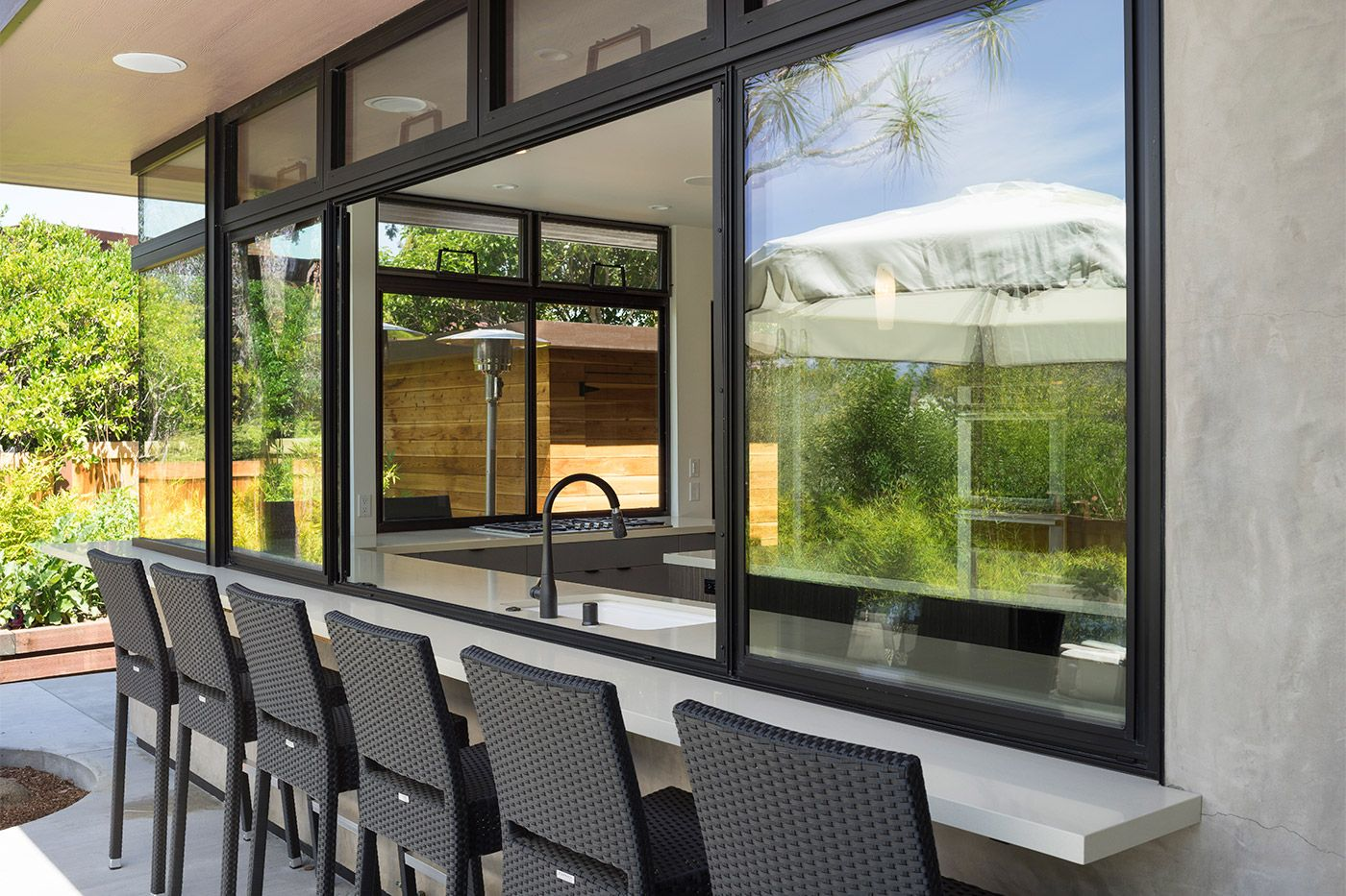 Custom modern design outdoor/indoor kitchen in this home design, architecture and construction near Stanford University