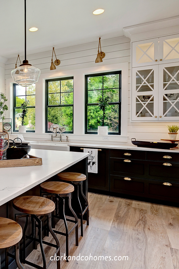 industrial stools add rustic texture to this otherwise clean lined black and white modern on farmhouse kitchen black and white id=29214