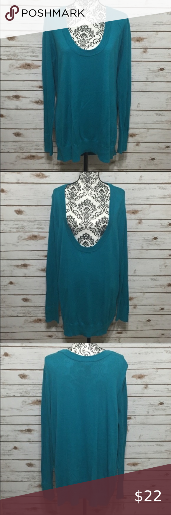 Lane Bryant Deep V-Neck Sweater Size 26/28 teal long sleeve deep v-neck sweater from Lane Bryant. Both sleeve cuffs have 4 buttons. 100% cotton. Sweater is in excellent, like new condition with no pilling.  -0214 Lane Bryant Sweaters V-Necks