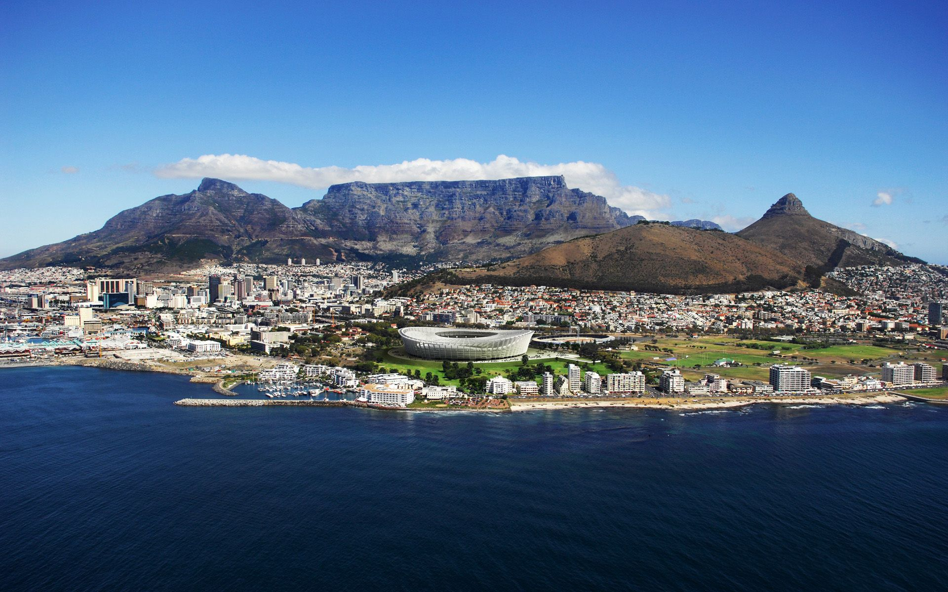 The iconic Table Mountain, so named because it's shape resembles that of a long table, in Cape Town, South Africa stands at the foot of the city and has become one of the 7 Wonders of the World