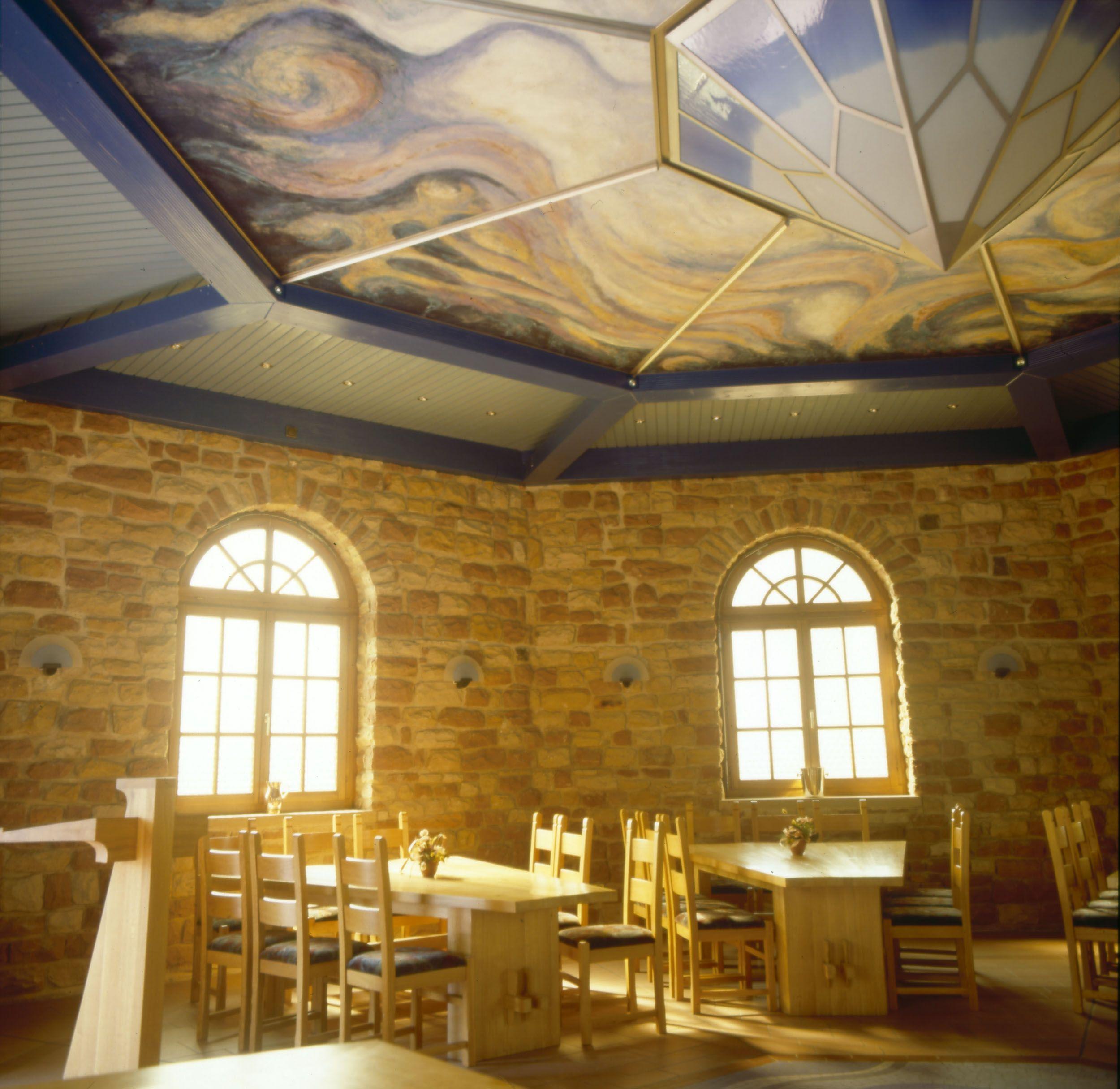 Wein und Kunst / Wine and Arts  Unsere Vinothek wurde von Herrn Vollmer Stein für Stein selbst gebaut. Die Decke wurde im Marc Chagall Stil bemahlt.  Artist Marc Chaghall