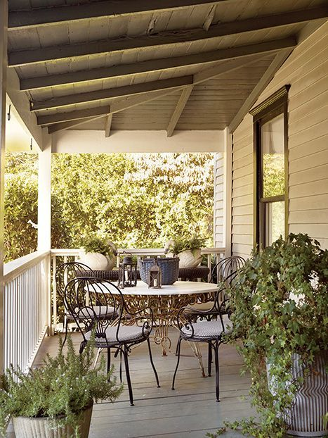 A Charming Atlanta Bungalow: Balloon Back Bistro Chairs And Containers Of  Ivy, Rosemary